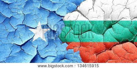 Somalia flag with Bulgaria flag on a grunge cracked wall