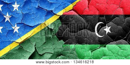 Solomon islands flag with Libya flag on a grunge cracked wall