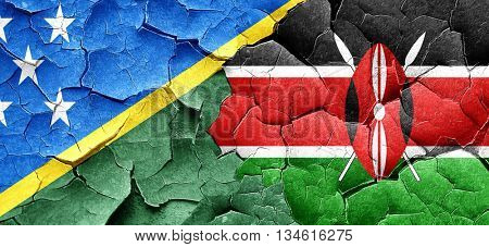 Solomon islands flag with Kenya flag on a grunge cracked wall