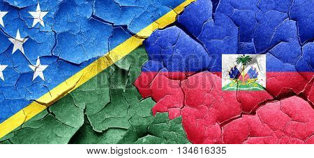 Solomon islands flag with Haiti flag on a grunge cracked wall