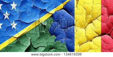 Solomon islands flag with Romania flag on a grunge cracked wall