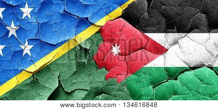 Solomon islands flag with Jordan flag on a grunge cracked wall