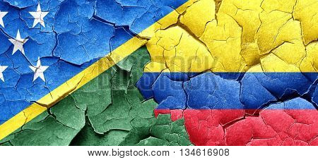 Solomon islands flag with Colombia flag on a grunge cracked wall