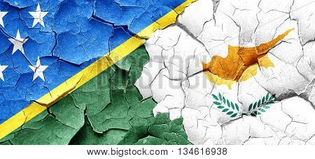 Solomon islands flag with Cyprus flag on a grunge cracked wall