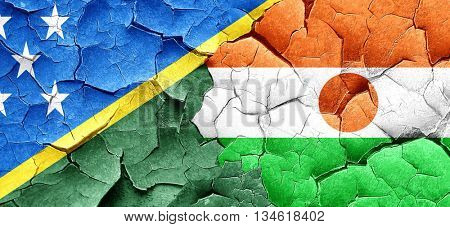 Solomon islands flag with Niger flag on a grunge cracked wall