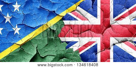 Solomon islands flag with Great Britain flag on a grunge cracked