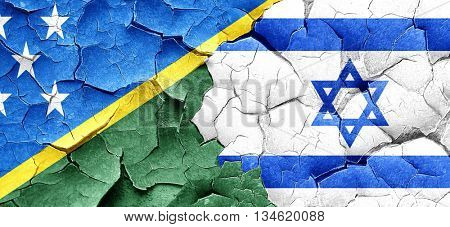 Solomon islands flag with Israel flag on a grunge cracked wall