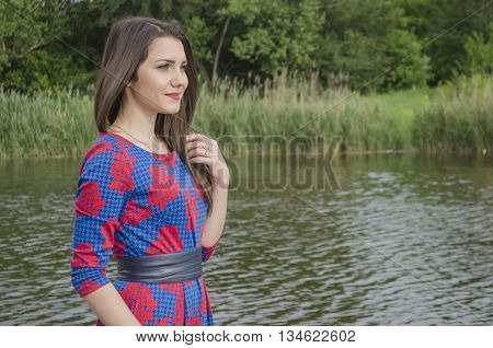 the young girl on the bank of the lake