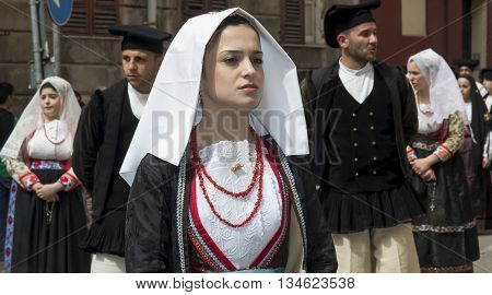 CAGLIARI, ITALY - May 1, 2013: 357 ^ Religious Procession of Sant'Efisio - Sardinia - portrait of a beautiful girl in traditional Sardinian costume