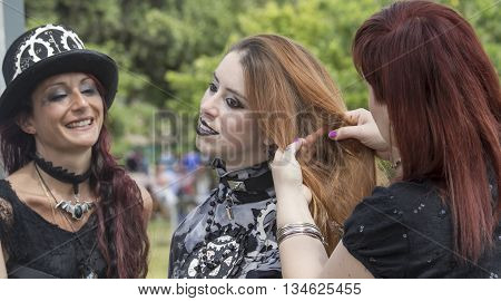 CAGLIARI, ITALY - June 1, 2014: Sunday at La Grande Jatte public gardens - Sardinia - group of beautiful girls in Victorian costumes