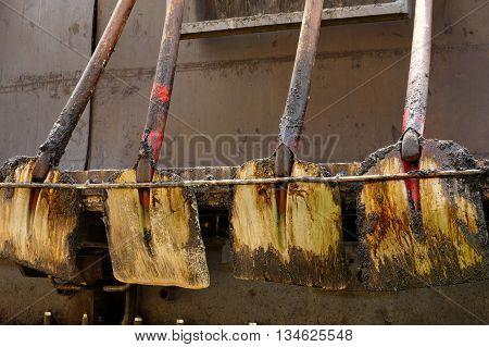 Shovels asphalt objects still life industries theme.