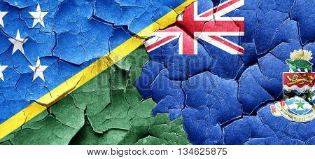 Solomon islands flag with Cayman islands flag on a grunge cracke