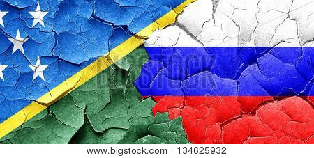 Solomon islands flag with Russia flag on a grunge cracked wall