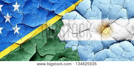 Solomon islands flag with Argentine flag on a grunge cracked wal
