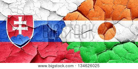 Slovakia flag with Niger flag on a grunge cracked wall