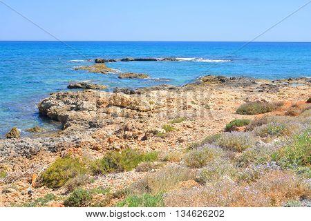 Rocks on the coast of Cretan Sea near Hersonissos Crete Greece.