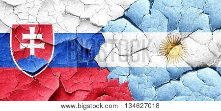 Slovakia flag with Argentine flag on a grunge cracked wall