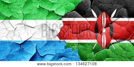 Sierra Leone flag with Kenya flag on a grunge cracked wall