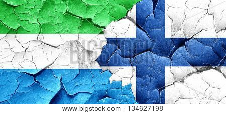 Sierra Leone flag with Finland flag on a grunge cracked wall