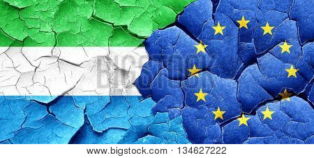 Sierra Leone flag with european union flag on a grunge cracked w