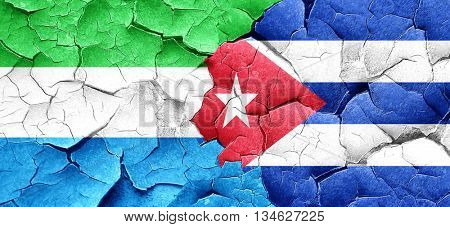 Sierra Leone flag with cuba flag on a grunge cracked wall