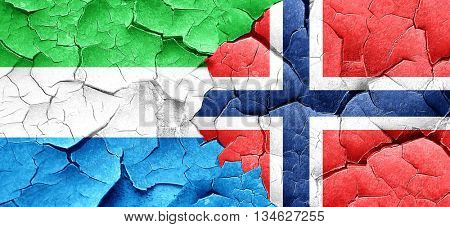 Sierra Leone flag with Norway flag on a grunge cracked wall