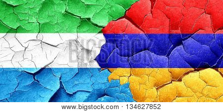 Sierra Leone flag with Armenia flag on a grunge cracked wall