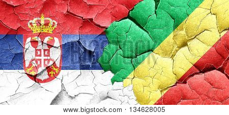 Serbia flag with congo flag on a grunge cracked wall