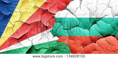 seychelles flag with Bulgaria flag on a grunge cracked wall