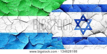Sierra Leone flag with Israel flag on a grunge cracked wall