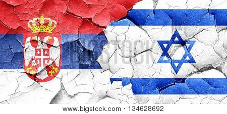 Serbia flag with Israel flag on a grunge cracked wall