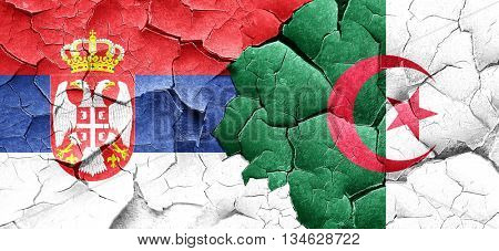 Serbia flag with Algeria flag on a grunge cracked wall