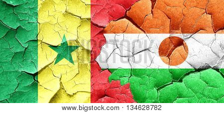 Senegal flag with Niger flag on a grunge cracked wall