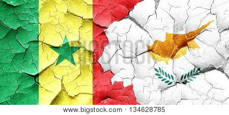 Senegal flag with Cyprus flag on a grunge cracked wall