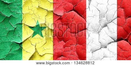 Senegal flag with Peru flag on a grunge cracked wall