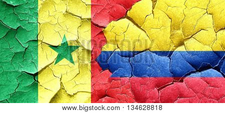 Senegal flag with Colombia flag on a grunge cracked wall