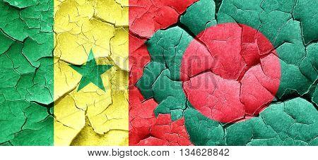 Senegal flag with Bangladesh flag on a grunge cracked wall
