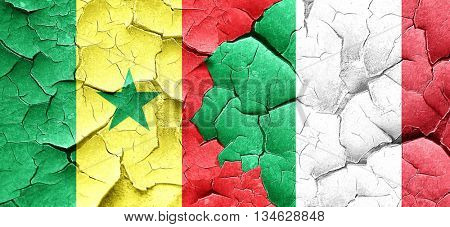 Senegal flag with Italy flag on a grunge cracked wall