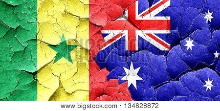 Senegal flag with Australia flag on a grunge cracked wall