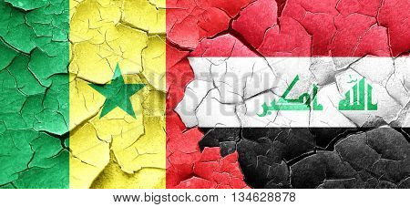 Senegal flag with Iraq flag on a grunge cracked wall