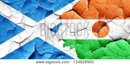 scotland flag with Niger flag on a grunge cracked wall