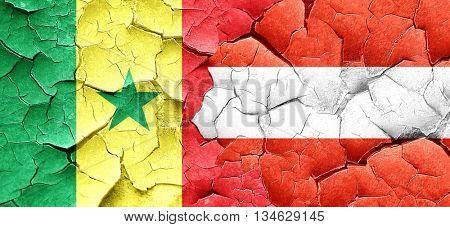 Senegal flag with Austria flag on a grunge cracked wall