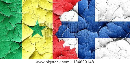 Senegal flag with Finland flag on a grunge cracked wall