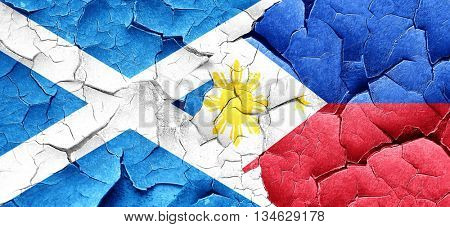 scotland flag with Philippines flag on a grunge cracked wall