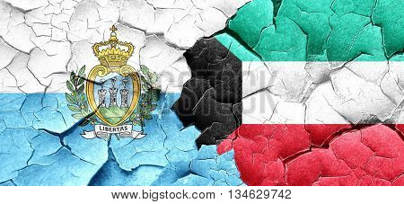 san marino flag with Kuwait flag on a grunge cracked wall