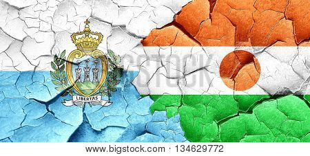 san marino flag with Niger flag on a grunge cracked wall