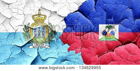 san marino flag with Haiti flag on a grunge cracked wall