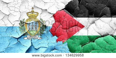 san marino flag with Palestine flag on a grunge cracked wall