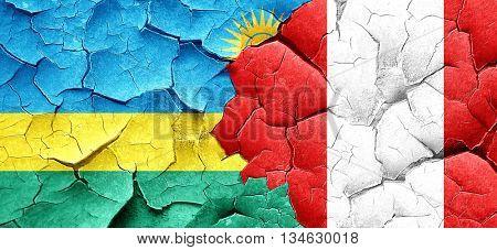 Rwanda flag with Peru flag on a grunge cracked wall
