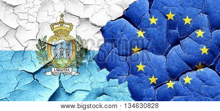san marino flag with european union flag on a grunge cracked wal